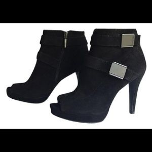 Black Calvin Klein boots.